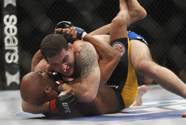 Chris Weidman, top, takes on Anderson Silva during UFC 168 at the MGM Grand Garden Arena. (Jason Bean/Las Vegas Review-Journal)