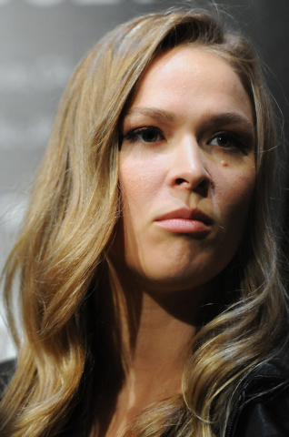 Ronda Rousey, Ultimate Fighting Championship women's bantamweight champion, is interviewed during media day at Mandalay Bay Events Center in Las Vegas Thursday, July 3, 2014. Rousey is slat ...