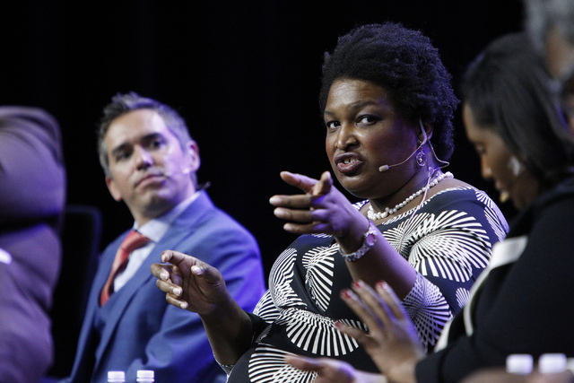 Rep. Stacey Abrams, D-Ga., center, speaks during a panel discussion on voter suppression during the annual NAACP convention at Mandalay Bay Convention Center in Las Vegas Tuesday, July 22, 2014. ( ...