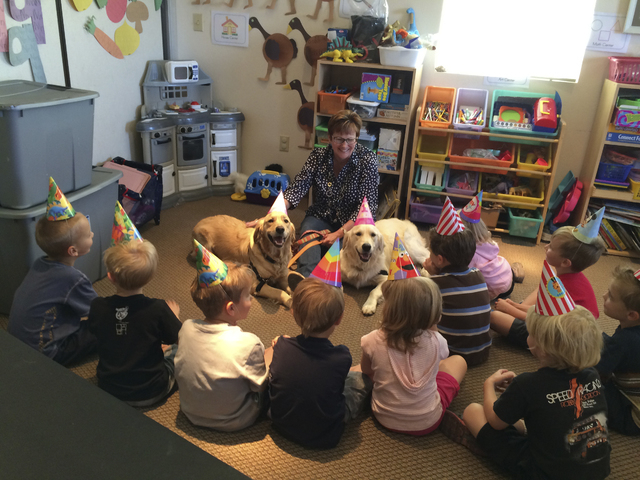In this photo from late April, the Rev. Marta Poling-Goldenne joins students from one of the New Song Christian Academy classes in celebrating the first birthday of the school's therapy-dogs-in-tr ...