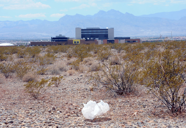 Trash floats across the desert near the Veterans Administration Hospital in North Las Vegas, Friday, July 11, 2014. Short-term growth in the city of North Las Vegas doesn't look good for the city  ...
