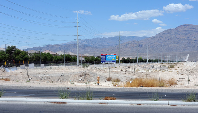 The corner of Elkhorn Road and Decatur Boulevard at the border of Las Vegas, on left, and North Las Vegas, on right, graphically shows the differences in growth in the two cities, Friday, July 11, ...