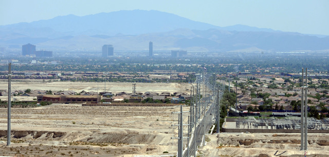 Large swatches of undeveloped land in North Las Vegas are seen to the left of developed Las Vegas residential areas, Friday, July 11, 2014. Short-term growth in the city of North Las Vegas doesn't ...
