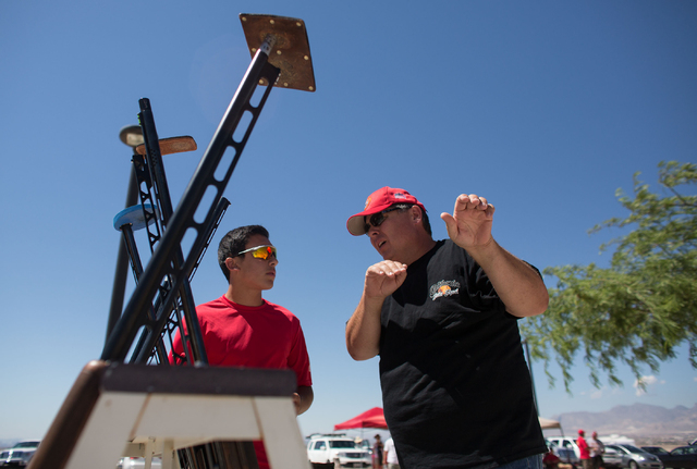 Christopher DeFrancesco (cq), left, talks with John Tarr (cq) during the U.S. Open for Youth Sport Shooting Championships at the Clark County Shooting Complex, 11357 N. Decatur Blvd., Friday, July ...