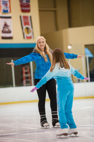 Skating instructor Harley Rhodes, left, teaches Saylor Hites, 9, how to ice skate during the Summer Fun on Ice program at the SOBE Ice Arena at the Fiesta Rancho, 2400 N. Rancho Drive, in Las Vega ...