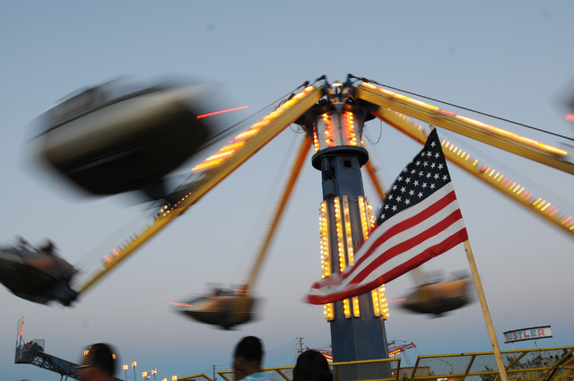 Visitors ride a carnival ride during the 15th annual Independence Day Jubilee at Craig Ranch Regional Park in North Las Vegas Thursday, July 3, 2014. (Erik Verduzco/Las Vegas Review Journal)