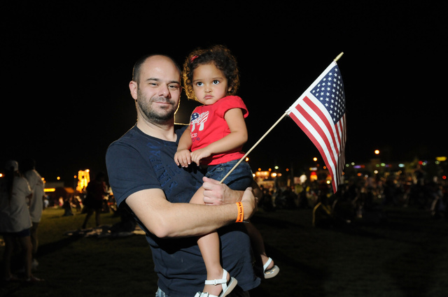 Steve Raimundez holds her daughter Mia, 3, as they pose for a photo during the 15th annual Independence Day Jubilee at Craig Ranch Regional Park in North Las Vegas Thursday, July 3, 2014. (Erik Ve ...