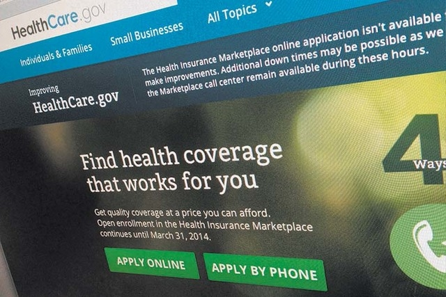 Part of the HealthCare.gov website is photographed in Washington. (AP Photo/Jon Elswick, File)