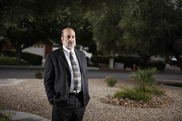 ACLU general counsel Allen Lichtenstein poses for a portrait in his front yard in Las Vegas Friday, Nov. 11, 2011. (John Locher/Las Vegas Review-Journal)