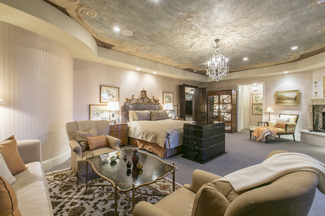 The master bedroom suite occupies 2,100 square feet on the second floor, including his- and-her baths. The ceiling is hand-painted on canvas. French sliding doors open onto a large balcony with te ...