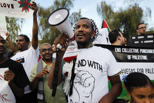 Abdi, last name withheld, shouts through a megaphone during a gathering to protest the violence in Gaza in front of the Lloyd George Federal Courthouse in Las Vegas on Saturday, July 19, 2014. (Ja ...