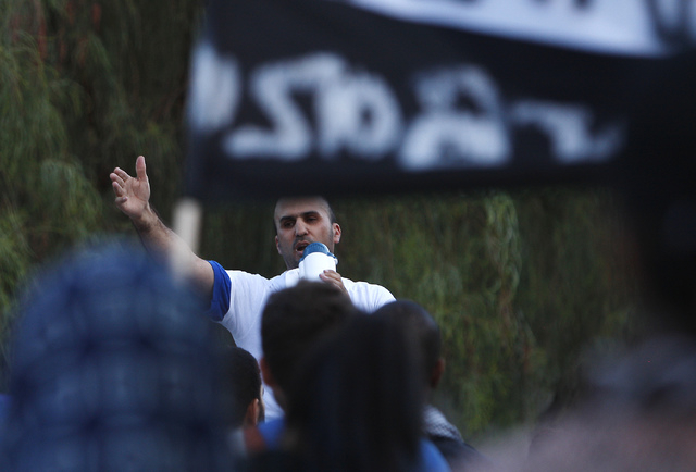 Ali Diab speaks during a gathering to protest the violence in Gaza in front of the Lloyd George Federal Courthouse in Las Vegas on Saturday, July 19, 2014. (Jason Bean/Las Vegas Review-Journal)