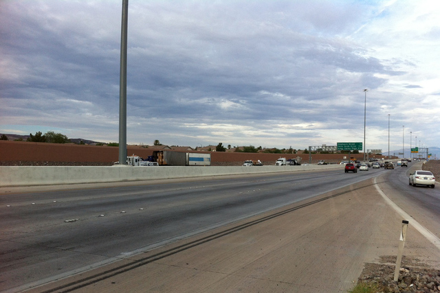 A jackknifed semitrailer closed the eastbound lanes of the 215 Beltway between Stephanie Street and Gibson Road Tuesday morning. (Michael Quine/Las Vegas Review-Journal)