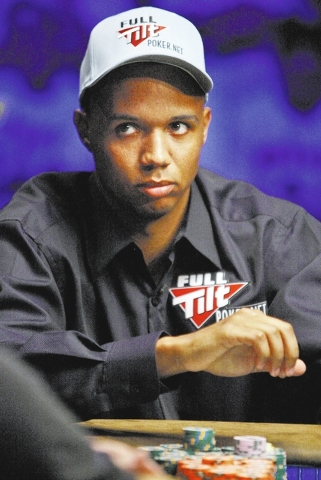 FILE - In this Nov. 7, 2009 file photo, Phil Ivey looks up during a hand at the final table of the World Series of Poker at the Rio Hotel and Casino in Las Vegas. Ivey, poker's biggest superstar,  ...