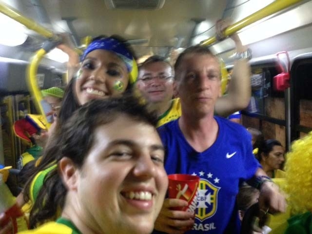 Post-game stadium transfer bus ride with Rey and Carla.