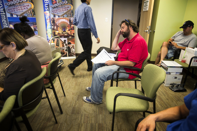 Steven Cooksey , medical marijuana licensing consultant for The Med Men, waits at the City of Las Vegas Department of Planning office,  333 Rancho Drive, on Wednesday, July 23, 2014.  Wednesday wa ...