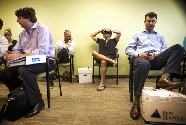 Medical marijuana  applications wait at the City of Las Vegas Department of Planning office,  333 Rancho Drive, on Wednesday, July 23, 2014.  Wednesday was the deadline for medical marijuana estab ...