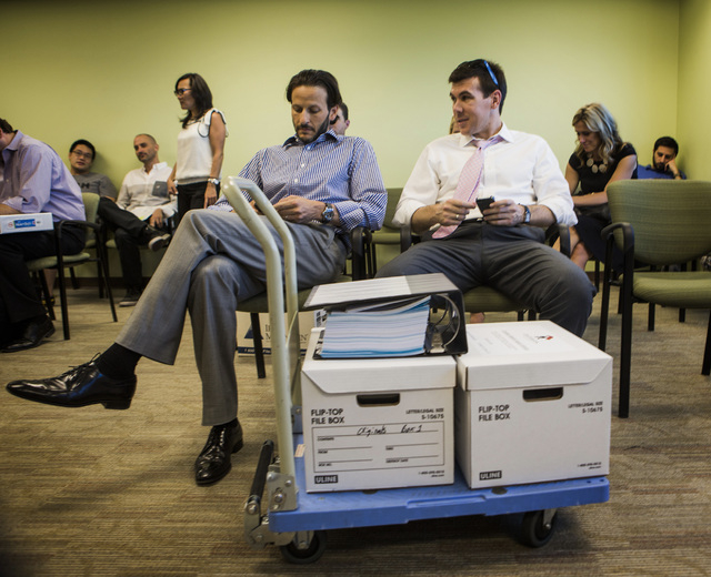Medical marijuana  applications J.T. Moran III,left, and Mathew Sibert, with GB Sciences LLC wait  at the City of Las Vegas Department of Planning office,  333 Rancho Drive, on Wednesday, July 23, ...