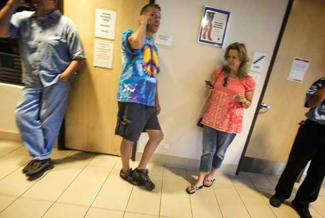 Medical marijuana application Karl Bonmar, center, with Desert Air Wellness, and consultant Lucy Stewart City stand in the hallway at the City of Las Vegas Planning & Development building,  333 Ra ...