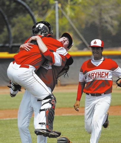 Las Vegas Mayhem pitcher Wes Morris (71) hugs his catcher Nolan Cassell (1) after defeating the Las Vegas Crusaders1-0 during their Connie Mack state championship baseball game at CSN in Henderson ...