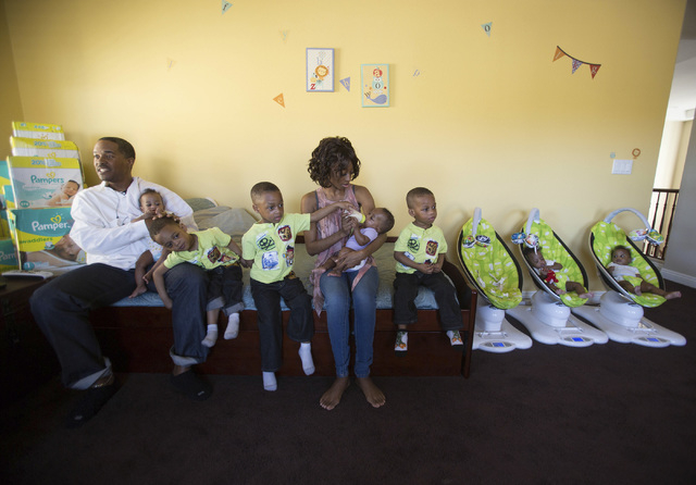 Deon Derrico, left, and his wife Evonne with their seven of their nine children at their home in North Las Vegas on Monday, March 24, 2014. Evonne Derrico gave birth to quintuplets on Sept. 6. (Je ...