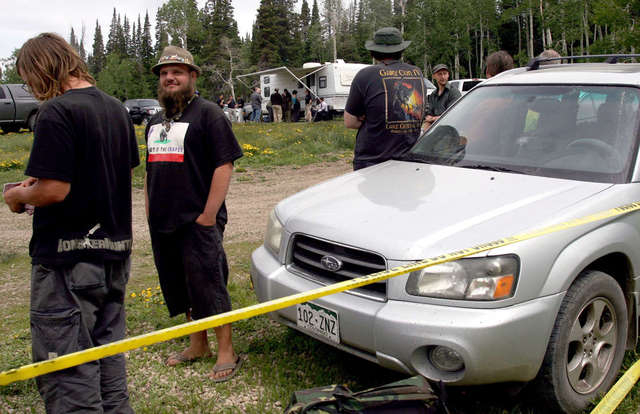 Rainbow Family members wait Thursday, June 26, 2014, to appear before U.S. Magistrate Dustin Pead at a site in the Uinta National Forest set up for initial court appearances. The hearings were hel ...