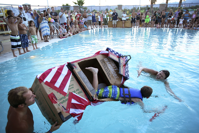 Gabe Pollock falls into the pool as his boat, USA, fails to stay upright during the Cardboard Boat Regatta at the Desert Breeze Aquatic Facility, 8275 Spring Mountain Road, Aug. 20, 2010. (Jason B ...