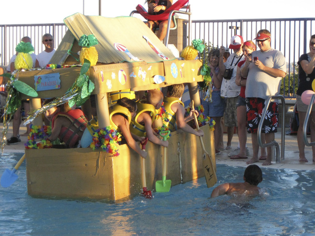 The tiki-hut inspired Fun In the Sun cardboard boat, powered by six rowers and by far the larges boat in the contest, attempts to make its way across the pool during the annual Cardboard Boat Rega ...