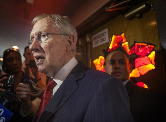 U.S. Sen. Harry Reid, D-Nev., speaks at the Hispanics in Politics breakfast at Dona Maria's Restaurant, 910 S. Las Vegas Boulevard, Wednesday, July 2, 2014. Reid on Tuesday confirmed he and his wi ...
