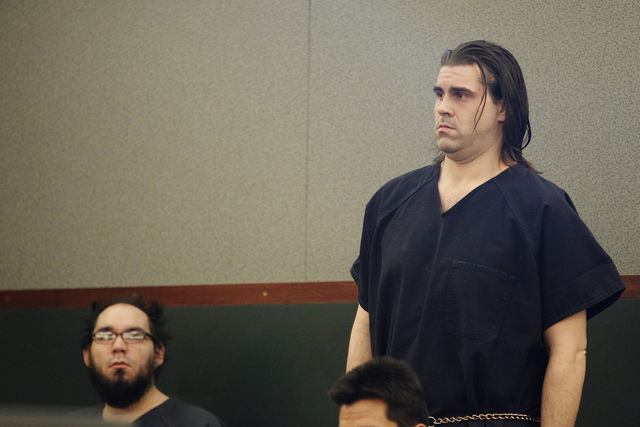 Christopher Reid, right, stands during his sentencing hearing at the Regional Justice Center in Las Vegas Tuesday, July 22, 2014. Reid pleaded guilty earlier this year to second degree murder in t ...