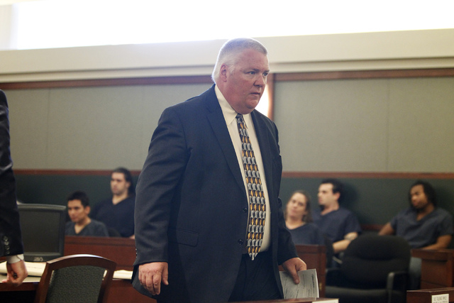 Defense Attorney Scott Coffee leaves the courtroom for a break during the sentencing hearing of his client Christopher Reid at the Regional Justice Center in Las Vegas Tuesday, July 22, 2014. Reid ...