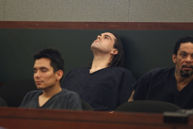 Christopher Reid, center, looks up as he waits during his sentencing hearing at the Regional Justice Center in Las Vegas Tuesday, July 22, 2014. Reid pleaded guilty earlier this year to second deg ...