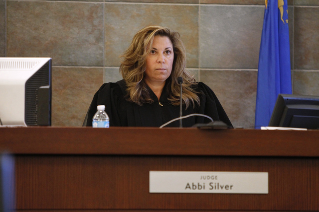 District Judge Abbi Silver hears words from Defense Attorney Scott Coffee during the sentencing hearing of his client Christopher Reid at the Regional Justice Center in Las Vegas Tuesday, July 22, ...