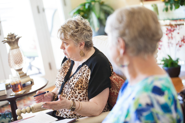 "Diana Huff, left, leader of the Book Leaf Club, of Mountain View Presbyterian Church, speaks during a group discussion about the novel ""The Book Thief"" by Markus Zusak at the home of gro ..."