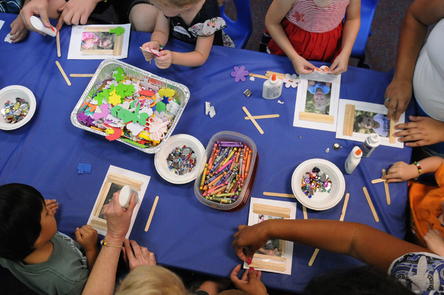 Children create photo frames using craft materials during a class at the Vacation Bible School at Upland Bible Church in Las Vegas Thursday, June 19, 2014. (Erik Verduzco/Las Vegas Review-Journal)