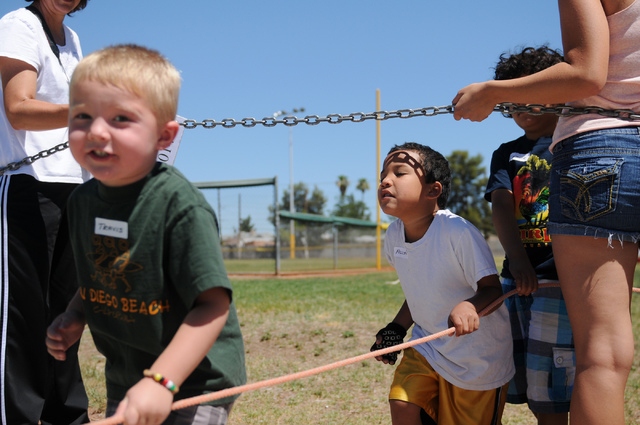 Travis Hodson, 4, left, and Allyn Salas, 6, leave Gary Dexter Park in Las Vegas after playing activities with their classmates from the Vacation Bible School at Upland Bible Church Thursday, June  ...