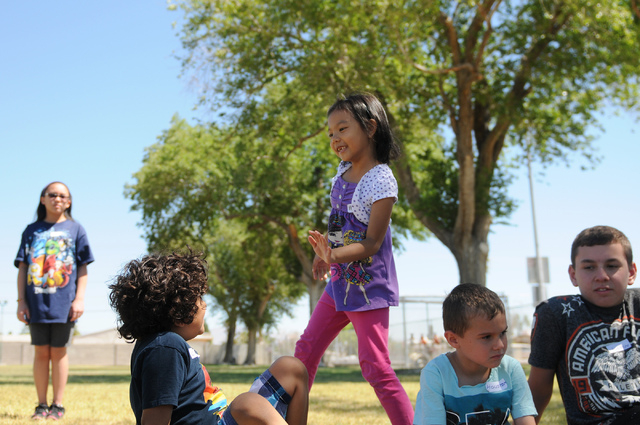 Melanie Eala, center, 6-year-old student at the Vacation Bible School at Upland Bible Church, plays activities with her classmates at Gary Dexter Park in Las Vegas Thursday, June 19, 2014. (Erik V ...