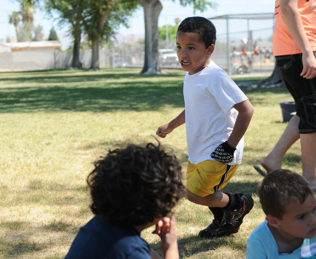 Allyn Salas, center, 6-year-old student at the Vacation Bible School at Upland Bible Church, plays activities with his classmates at Gary Dexter Park in Las Vegas Thursday, June 19, 2014. (Erik Ve ...