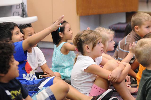 Children in the Vacation Bible School at Upland Bible Church in Las Vegas listen during story time Thursday, June 19, 2014. (Erik Verduzco/Las Vegas Review-Journal)