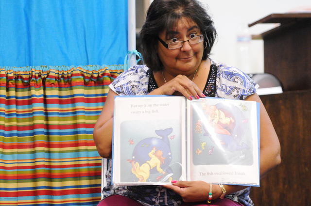 Irene Cahoon, volunteer instructor at the Vacation Bible School at Upland Bible Church in Las Vegas, hosts story time for children in her class Thursday, June 19, 2014. (Erik Verduzco/Las Vegas Re ...