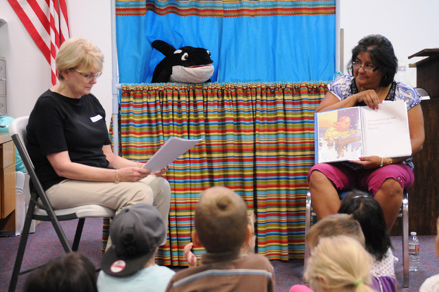 Sue Lepczyk, left, and Irene Cahoon, volunteer instructors at the Vacation Bible School at Upland Bible Church in Las Vegas, host story time for children in their class Thursday, June 19, 2014. (E ...
