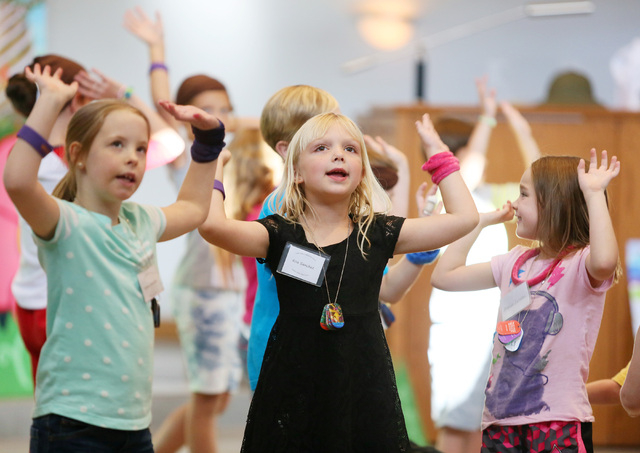 Koa Sanchez, 6, center sings and dances with other children during vacation Bible school at Green Valley Presbyterian Church Thursday, June 19, 2013, in Henderson. Maken Lintner, 6, right, dances  ...