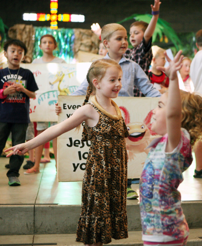 DAnica Saeger, 7, center, sings and dances during vacation Bible school at Green Valley Presbyterian Church Thursday, June 19, 2013, in Henderson. The camp is a week-long evening program that serv ...