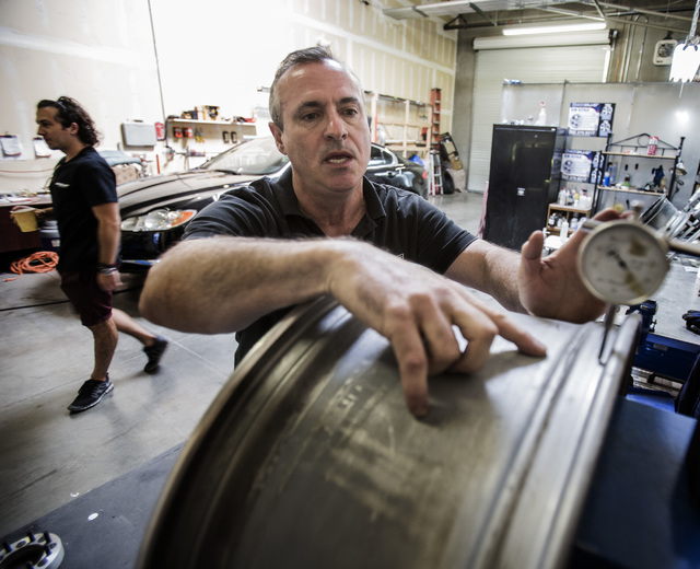 Paul Seidler, owner of Kwicksilver wheel repair business, 50 North Gibson, Suite 150, in Henderson works on aligning a custom rim on Wednesday, June 25, 2014.  Seidler worked in the White House to ...