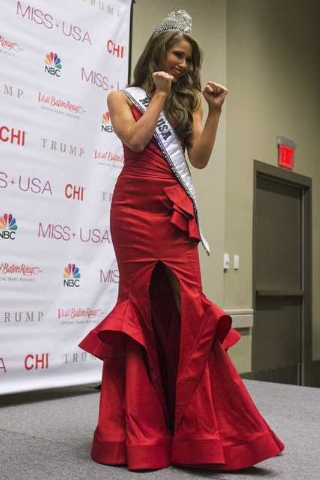 Miss Nevada Nia Sanchez poses in a taekwondo martial art stance for the media at a news conference after she won the 2014 Miss USA beauty pageant in Baton Rouge, Louisiana June 8, 2014. Fifty-one  ...