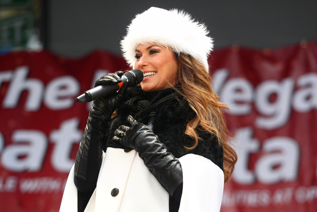 Shania Twain welcomes attendees at the Third Street Stage at the Fremont Street Experience before the Great Santa Run in downtown Las Vegas on Saturday, Dec. 7, 2013. Over 11,000 people participat ...