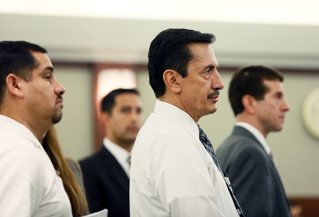 Jaime Espitia, far left, and Andres Mendoza, third from left, appear in Judge Kenneth Cory's courtroom at Regional Justice Center Monday. Espitia and Mendoza are part of a group of five people w ...