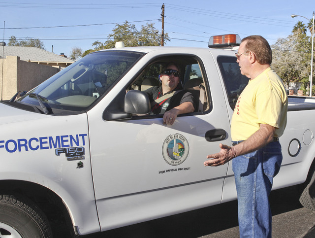 Gary Bates talks with Anthony Rogers of Las Vegas Code Enforcement about a dumpster left out in his neighborhood in Las Vegas, Monday, Nov. 19, 2012. Gary, who died on Friday, took care of his nei ...