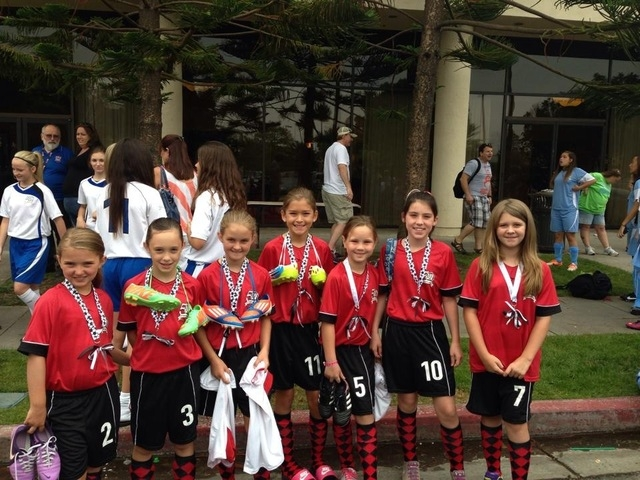 Members of American Youth Soccer Organization Red Hots team are seen in California the first week of July for the national finals. From left are Rylie Bush, Emma Hoffman, Charlotte Bonney, Sabrina ...