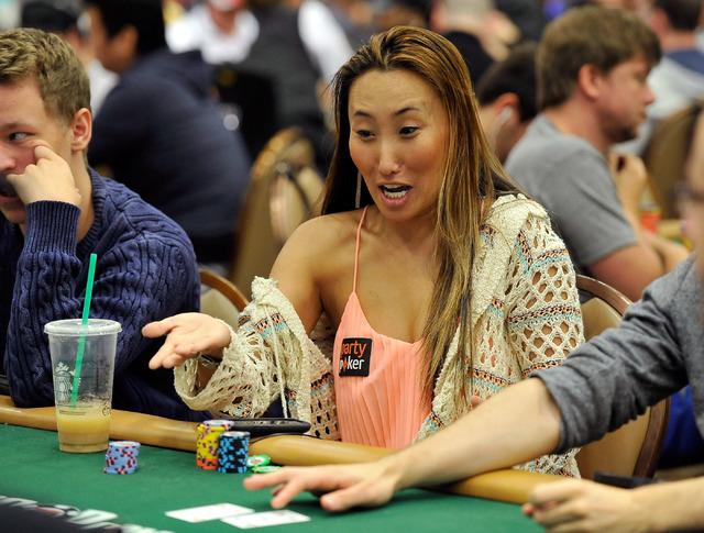 Melissa Burr reacts to cards being flopped during day 2A/2B of the World Series of Poker Main Event at the Rio hotel-casino on Tuesday, July 8, 2014. (David Becker/Las Vegas Review-Journal)